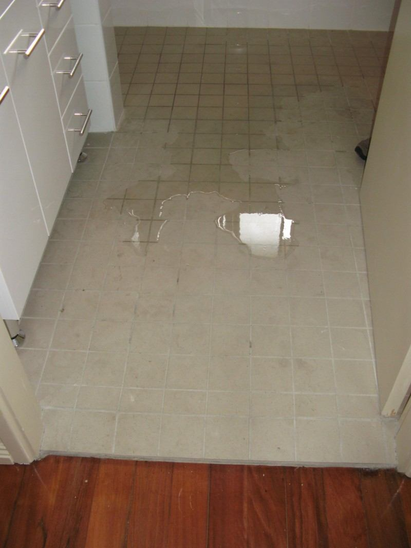 bathroom wet floor wood floors